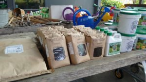 Our bags of worm castings biofertilizer on the shelf at Evergreen Garden Market